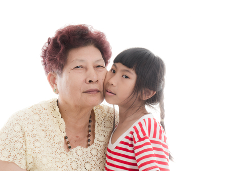 girl  care: Grandmother holding granddaughter with love Stock Photo