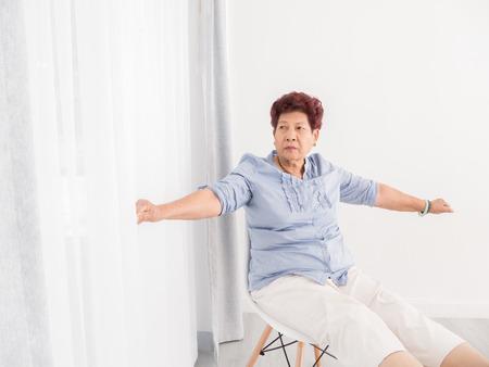 thai stretch: Asian Senior woman relax at home. Stock Photo
