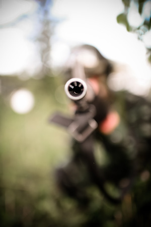 maneuver: Selective focus soldier maneuver with machine gun Stock Photo