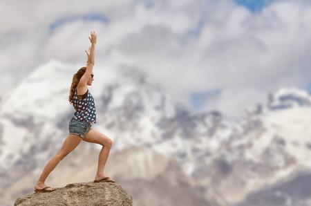 meditaion: Woman doing yoga with Himayalayan mountain background. Stock Photo