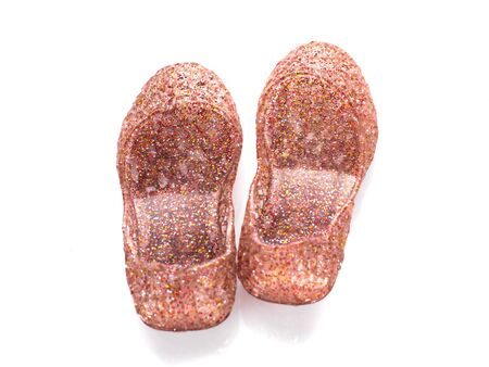 pretty s shiny: Little girls red sparkly shoes on white. Stock Photo