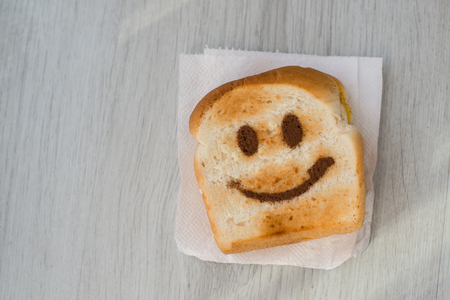 toasted: Happy toasted on wooden table. Stock Photo
