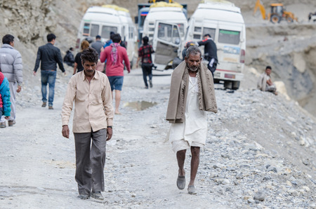 affected: Ladakh,India - July 20,2015 : Indian Travelers waiting worker clear the road to Manali affected by landslide