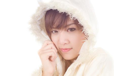 anorak: Beautiful Woman with winter anorak sitting on white background.