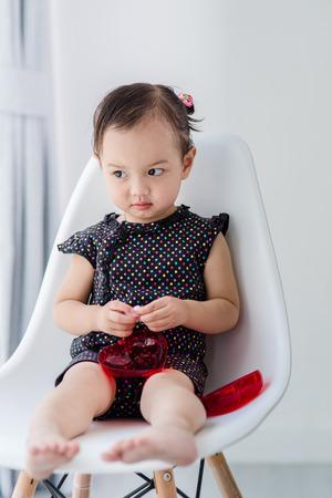 marshmellow: Cuter Asian girl eating marshmellow at home