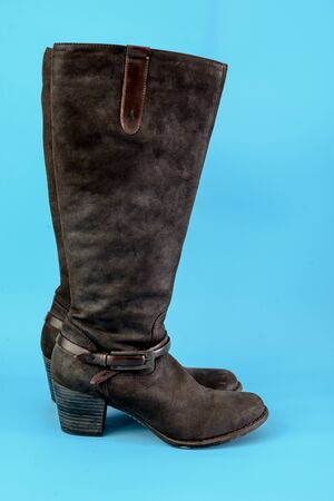 knee boots: Long boots on blue background.
