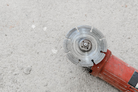 stone cutter: Electric angle grinder at construction building site during roadworks, top view