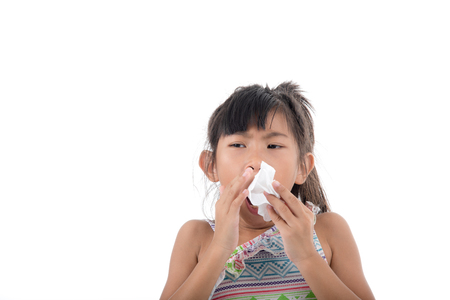 allergy: Flu cold or allergy symptom.Sick young asian girl with fever sneezing in tissue,allergies,the common cold,with blank copy space on white