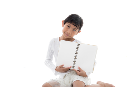 two page spread: Asian girl sitting and holding blank notebook on white background.