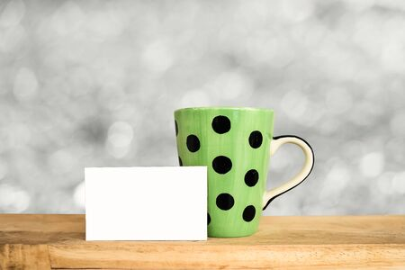 blak and white: cup of coffee and a cup on the table, mock up
