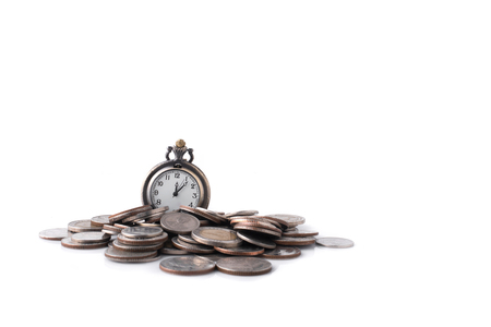 pocketwatch: Time is money concept. Coins and an old pocket-watch. Selective focus.