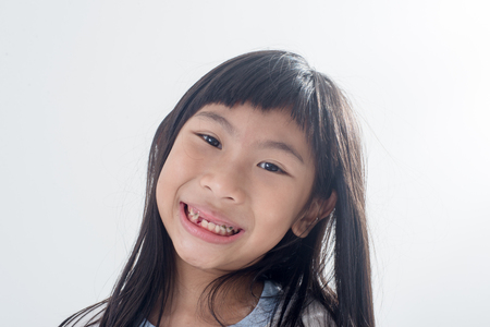 baby tooth: Asian child has lost the baby tooth