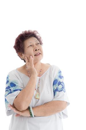 over white background: happy elderly woman. Isolated over white background