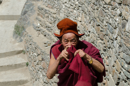 tantric: ZANSKAR, INDIA - JULY 15, 2015 : Untitled lama waiting for mystical mask dancing at Karsha Monastery (one of the oldest monastery), Zanskar, North India Editorial