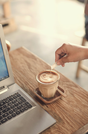 unrecognisable people: Man adding sugar to his coffee