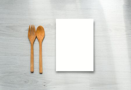 Mock up paper display and wooden spoon and fork on gray wooden floors