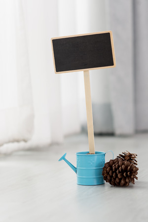 magnesia: Small wooden framed blank blackboard over a window with blue flower pot
