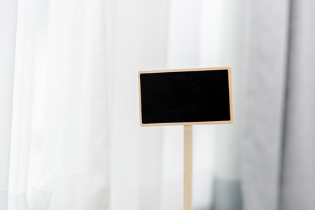 magnesia: Small wooden framed blank blackboard over a window Stock Photo