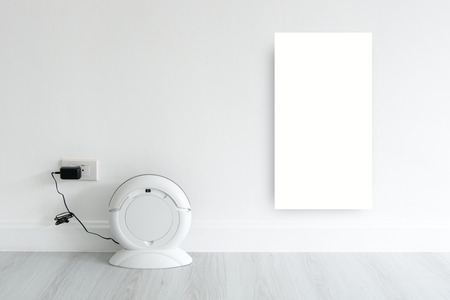 discard: Mock up white discard with Cleaning robot charging at white wall with copy space for display