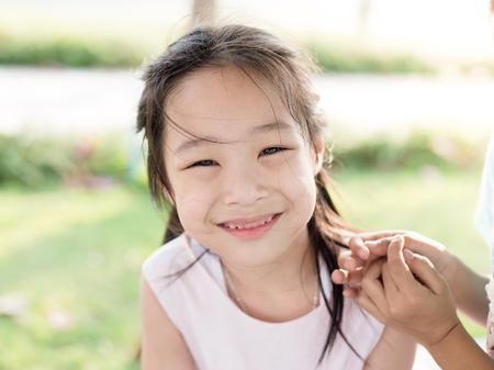 black asian: Happy Asian girl outdoor.
