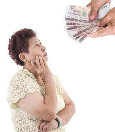 earing: Portrait of Asian elderly woman thinking about money, isolated over white background. Stock Photo