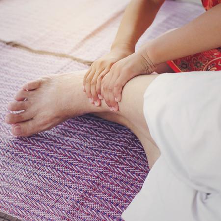 traditional healer: Asian Girl massage her grandmother. Stock Photo
