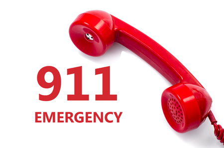 Old and dust red retro phone on white, Urgently emergency service concept. Banco de Imagens