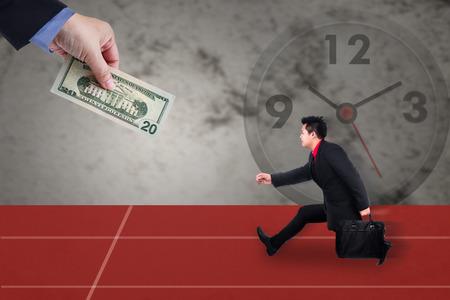 money metaphor: Businessman chase people with money metaphor