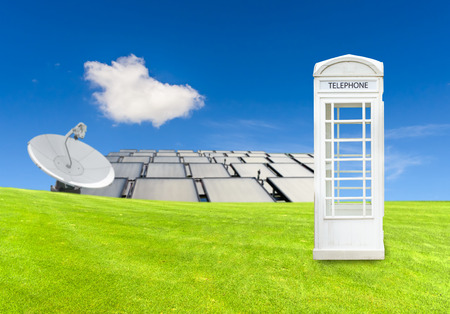 cell phone booth: beautiful landscape with green meadow, and white telephone box,antenna background