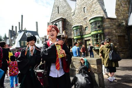 holiday blockbuster: OSAKA, JAPAN - OCTOBER 13, 2016: Untitled Japanese in wizard cosplay at Diagon alley at Wizarding World of Harry Potter at Universal Studios Osaka, Japan. Editorial