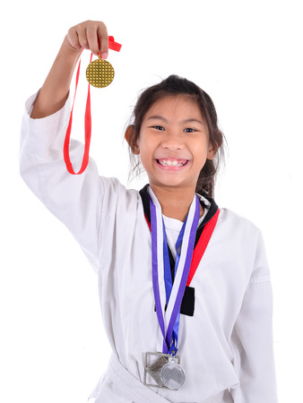 monedas antiguas: chica asiática en taekwondo con el fondo.