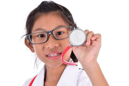 Young female doctor using stethoscope, isolated over a white background, selective focused Stock Photo