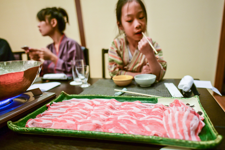 Japanese food, big sliced pork tray on table ready to cook photo