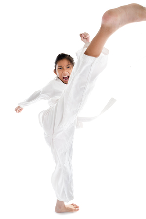 Tae Kwon Do Asian girl on white background Stockfoto