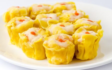 Chinese steamed shrimp dumplings on white dish