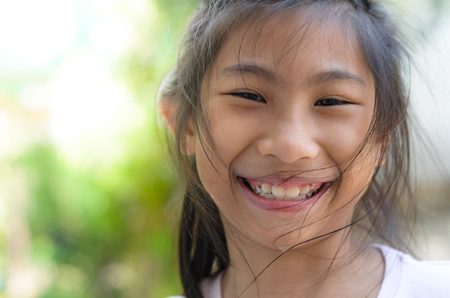 Happy smily face Asian girl with bokeh background, copy space.
