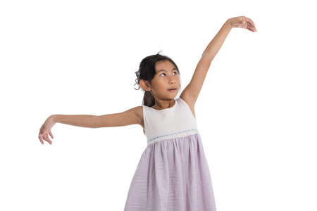 Happy girl dancing on white background. Banque d'images