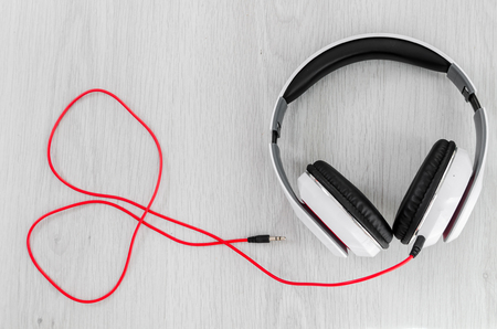 Headphone with red line in heart shape on gray background. Stok Fotoğraf