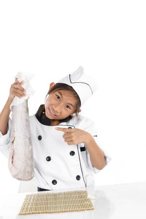 Surprising chef in uniform holding big freezing fish on white background.