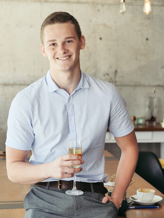 Start-up successful businessman celebrating with a glass of champagne. 写真素材