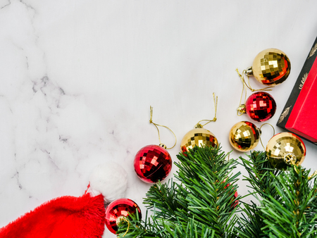 Christmas tree and santa hat decorating on marble background, top view. Stock Photo