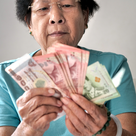 Senior woman receive subsistence allowance from government, lifestyle concept. Reklamní fotografie