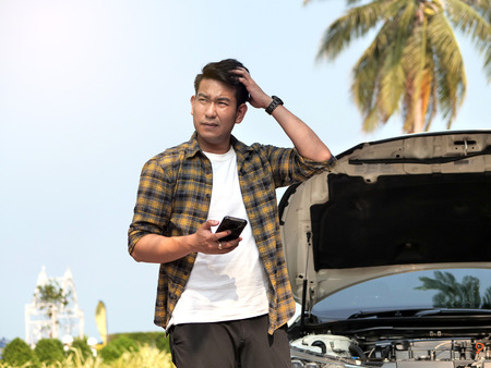 Man is calling a car mechanic and he very stressed because of his car breakdown