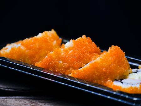 Sushi maki california roll are mood tone color orange. repeat pattern japanese food Stock Photo