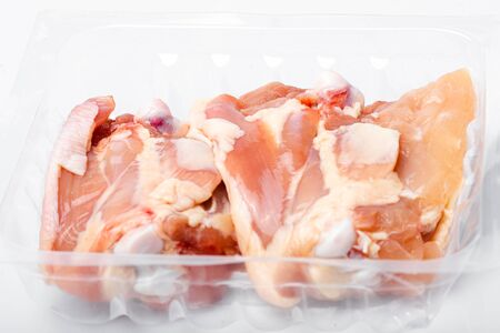 Chicken thighs in plastic pack from supermarket, ready to cook. Banco de Imagens