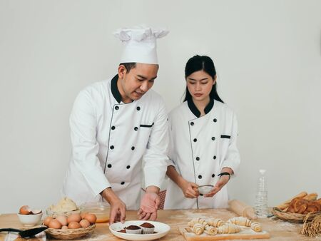 Asian chefs prepareing food on table, lifestyle concept.
