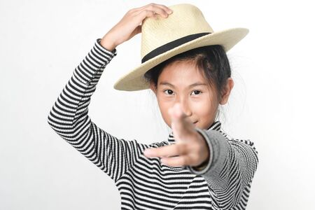 Happy Asian girl waering turtle neck and straw hat on white background.