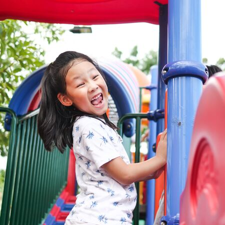 Asian girl playing at playground, lifestyle concept.