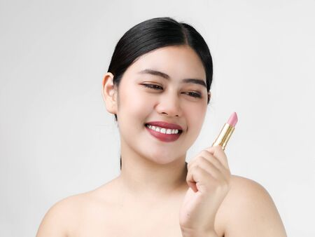 Young Asian woman model with bright makeup with perfect clean skin with pink lips and lipstick.