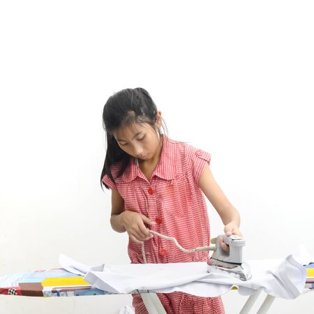 Asian girl ironing clothes at home, lifestyle concept. Stock Photo